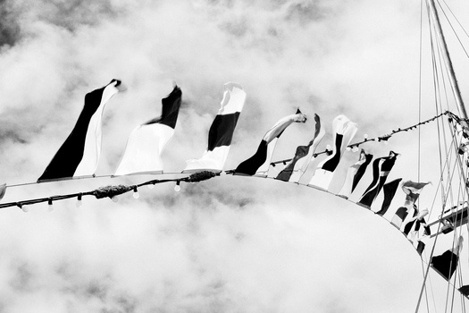 black-and-white-sky-flags-boat-medium